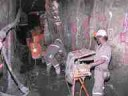 Underground development work using a jumbo drill.