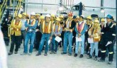 """Lac des Iles employees listening to president and CEO Keith Minty's quarterly address in June 2001. """"There is strong support for Keith on many levels,"""" says general manager Stephen Stine. """"The workers respect his abilities and accomplishments. Keith told them two years ago that he would turn around this operation, and he has."""""""