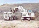 Liebherr mining truck T 252, with payload capacity of 173-195 tonnes (left), and 400-t R 995 Litronic mining excavator in action at an Indonesian coal mine.