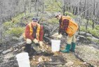 Robert Lucas of Ashton (left) and Ghislain Poirier of Soquem collecting and sieving a basal till sample in the search for diamond indicator minerals, in northern Qubec, summer 2000.