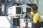 Employee at Noranda Recycling's LaVergne, Tennessee plant disassembles computer