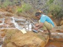 Environmental monitoring plans and mitigation measures have been identified and will be employed throughout the life of the Goro project. Above, water samples from around the future mine site are collected and measured.