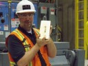 Denis Cimon, general manager of the Canadian Malartic mine, holds the first dor bar poured in April 2011. (Photo: Osisko Mining)