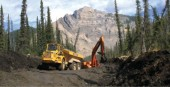 Heavy equipment works on a portion of the 175-km winter access road that will connect the mine with southern road lnks.