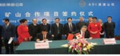 Observers representing Canada and China watch as company officials sign an agreement to move forward with the Lac Otelnuk project.