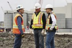 President and CEO Gerald Panneton speaks with Pierre Beaudoin, COO (left) and Director of Operations, Drew Anwyll (right) during construction in October 2011.