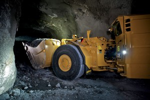 A Cat LHD works deep underground and far from the operators located safely at a command centre in a different part of the mine.