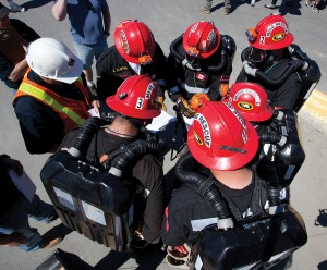 A mine rescue team huddles for a safety briefing at Dominion Diamond's Ekati mine. (Dominion Diamond Corporation photo)