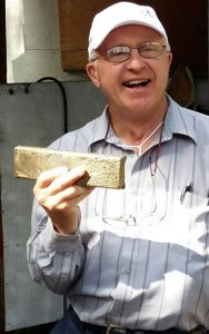 Golden Predator director Brad Thiele with the first gold bar poured from the bulk sample of the Ace of Spades vein at the 3 Aces project.