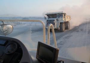 A Terrex TR100 plows through winter.