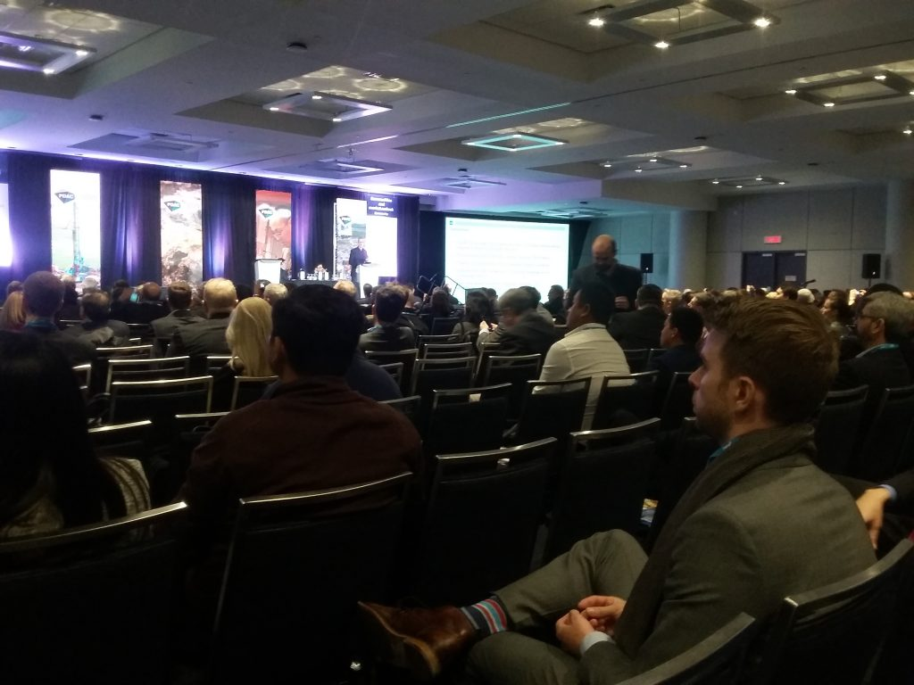 Paul Robinson, a director at CRU Group, speaks at the Prospectors and Developers Association of Canada convention in Toronto. Credit: Canadian Mining Journal