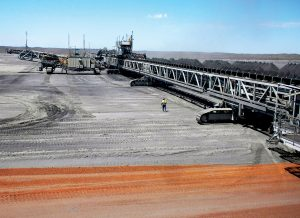 Tracked conveyor bridge, versatile mobile stacking technology, mobile conveyors and advance and retreat stacking. Credit: FLSmidth