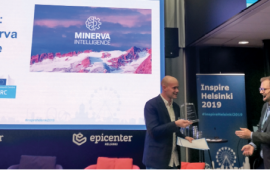 Jake McGregor, COO of Minerva Intelligence accepting first prize for the Helsinki Challenge in 2019. Minerva's geohazard division designed an application identifying areas in Veneto, Italy, that are susceptible to landslides. Credit: Minerva Intelligence