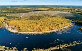 Far left: The rehabilitated Claude mining area. Credit: Orano Canada