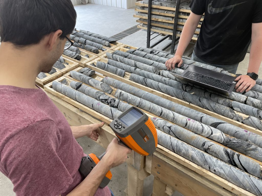People examining drill core